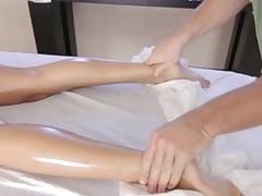 Massuer is having joy giving hot honey a carnal massage